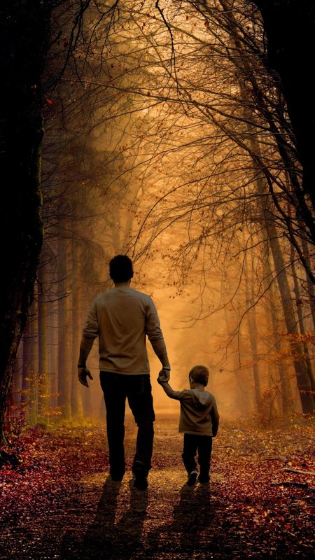 father and son walking in the jungle Wallpaper